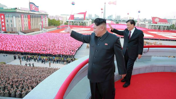 North Korean leader Kim Jong Un (L) and senior Chinese Communist Party official Liu Yunshan (R) wave during celebration of the 70th anniversary of the founding of the ruling Workers' Party of Korea, in this undated photo released by North Korea's Korean Central News Agency (KCNA) in Pyongyang on October 12, 2015 - Sputnik International
