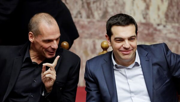 Greece's Prime Minister Alexis Tsipras, right, and Finance Minister Yanis Varoufakis chat during a Presidential vote in Athens, on Wednesday, Feb. 18, 2015. - Sputnik International