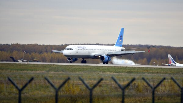 In this photo taken on Tuesday, Oct. 20, 2015, The Russian airline Kogalymavia's Airbus A321 with a tail number of EI-ETJ on an airstrip of Moscow's Domodedovo international airport, outside Moscow, Russia - Sputnik International