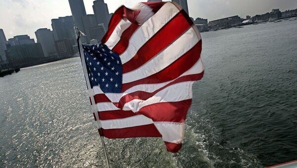 A United States flag flies on a ship of Massachusetts Bay Lines, Inc., against Boston skyline during Birth of A Nation Harbor Tours in Boston, Tuesday, July 11, 2006 - Sputnik International