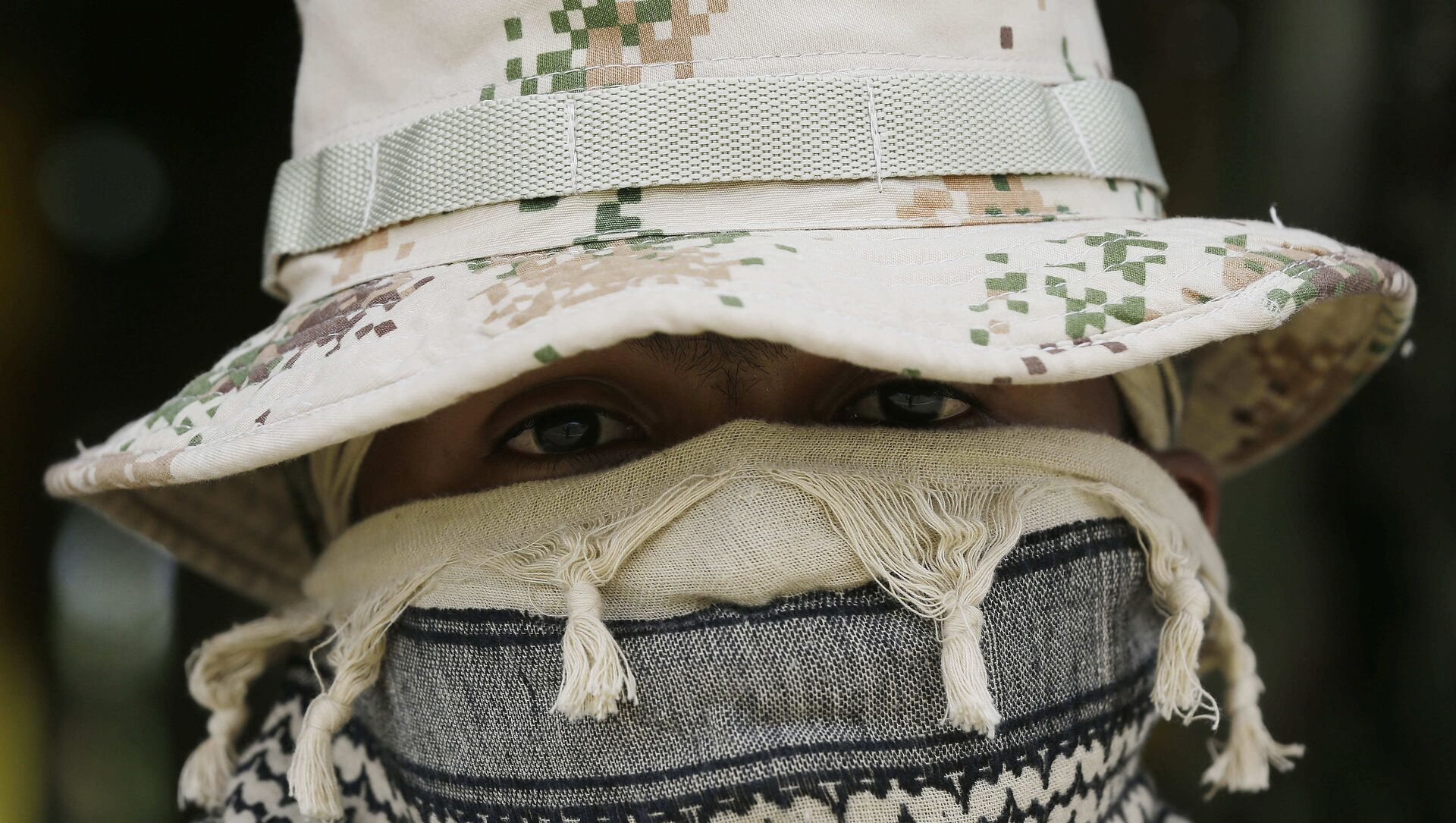 A Colombian Army Special Forces soldier waits to take part in a show of military exercises at the Tolemaida military base - Sputnik International, 1920, 28.07.2021