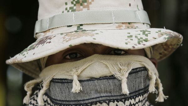 A Colombian Army Special Forces soldier waits to take part in a show of military exercises at the Tolemaida military base - Sputnik International