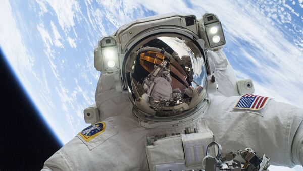 Astronaut Mike Hopkins, Expedition 38 Flight Engineer, is shown in this handout photo provided by NASA as he participates in the second of two spacewalks which took place on December 24, 2013 - Sputnik International