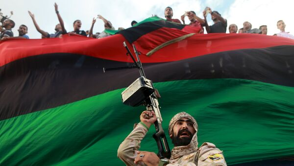 One of the members of the military protecting a demonstration against candidates for a national unity government proposed by U.N. envoy for Libya Bernardino Leon, is pictured in Benghazi, Libya October 23, 2015. - Sputnik International