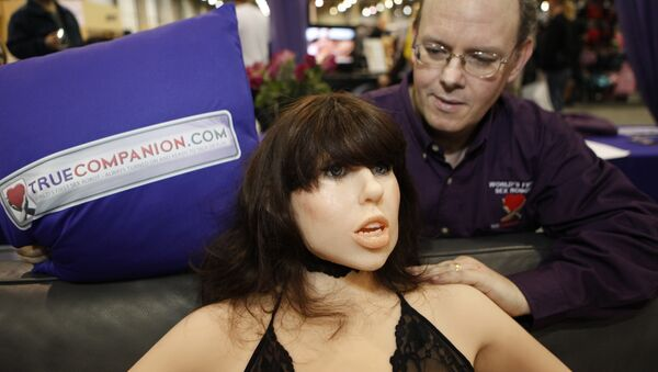 Douglas Hines, founder of True Companion, poses with a life-size rubber doll named Roxxxy during the Adult Entertainment Expo in Las Vegas, Saturday, Jan. 9, 2010. - Sputnik International