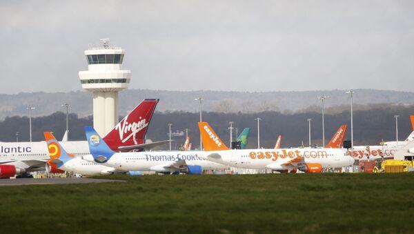 Airplanes stand idle at London's Gatwick Airport, England - Sputnik International