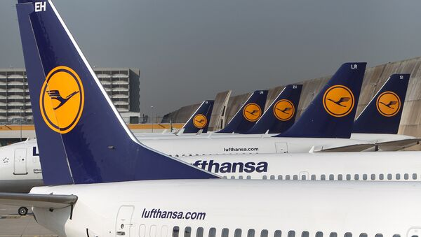 FILES - Aircrafts of German airline Lufthansa stand in park position at the airport in Frankfurt am Main, western Germany. - Sputnik International