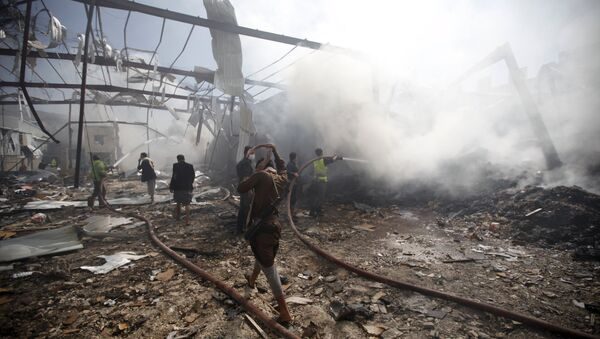 Firefighters extinguish a fire at a food storage warehouse hit by a Saudi-led air strike in Yemen's capital Sanaa October 25, 2015 - Sputnik International