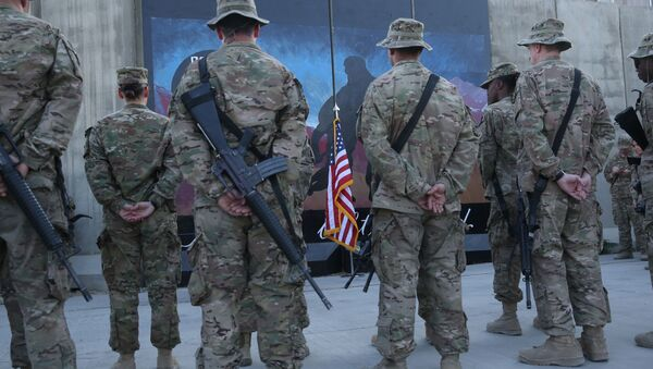 U.S. service members stand in front of a U.S. flag during a ceremony on the thirteenth anniversary of the 9/11 terrorist attacks in front of the World Trade Center Memorial at Bagram Airfield, Afghanistan, Thursday, Sept. 11, 2014 - Sputnik International