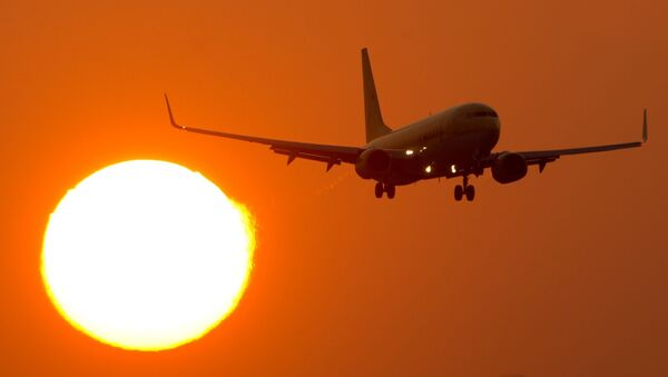 A Boeing 737 flies at the airport Stuttgart, southern Germany, as sun downs on March 14, 2014 - Sputnik International