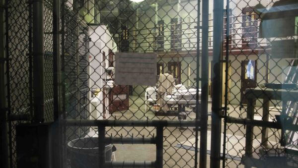 In this photo reviewed by the U.S. military, a prisoner stands with his back turned inside Camp 6, a communal unit of the Guantanamo Bay detention center for prisoners who are considered highly compliant with the rules, at Guantanamo Bay Naval Base, Cuba, Saturday, June 7, 2014 - Sputnik International