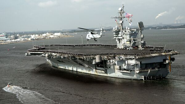 This 13 December, 2004 US Navy handout image shows the conventionally powered aircraft carrier USS John F. Kennedy (CV 67) as she returns to her homeport of Mayport, Florida - Sputnik International