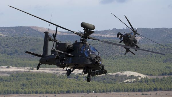 NATO forces in AH-64 Apache helicopters take part in Exercise Trident Juncture 2015, NATO's largest joint and combined military exercise in more than a decade, at the San Gregorio training grounds outside Zaragoza, Spain, November 4, 2015 - Sputnik International