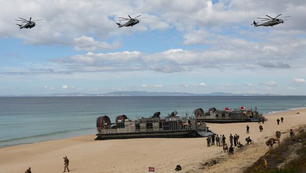 FILE - In this Oct. 20, 2015 file photo, U.S. navy helicopters fly over U.S. Navy hovercraft during the NATO Trident Juncture exercise 2015 at Raposa Media beach in Pinheiro da Cruz, south of Lisbon - Sputnik International