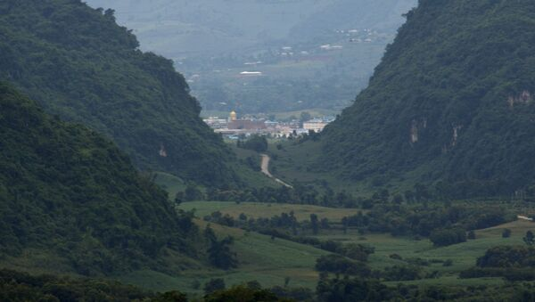 Myanmar's Kokang region seen from the Chinese side from a hill top observation pavilion in Nansan in southwestern China's Yunnan province. - Sputnik International