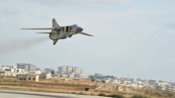 The Soviet-made MiG-23 fighter of the Syrian Air Force flies over the Hama airbase - Sputnik International