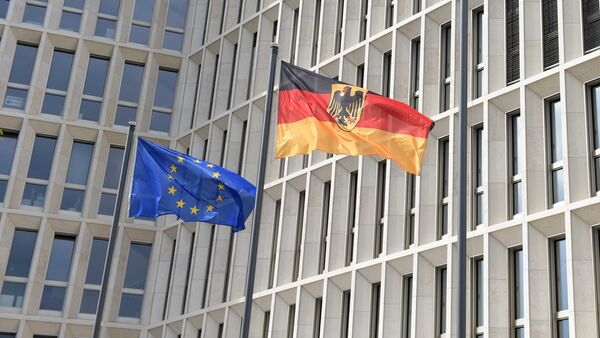 The German (R) and the European flag fly in the wind outside the new Federal Ministry of the Interior building in Berlin on April 26, 2015 - Sputnik International