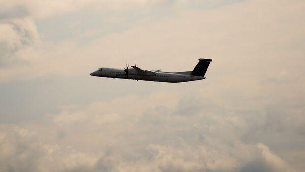 Dash 8 airplane - Sputnik International