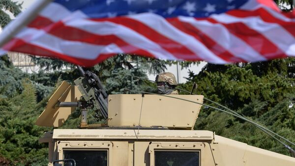 A US soldier looks from the armored vehicle Humvee as US military convoy arrives to the Czech army barracks on March 30, 2015 in Prague after entering the Czech Republic at the border crossing in Harrachov on the way from Baltic countries to base in Vilseck, southern Germany - Sputnik International