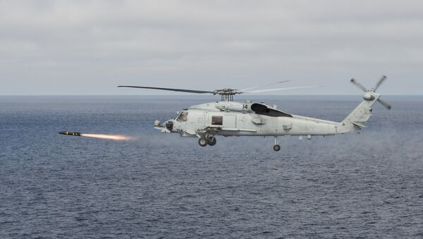 An MH-60R Sea Hawk helicopter attached to the Raptors of Helicopter Maritime Strike Squadron (HSM) 71 fires an AGM-114 Hellfire missile during a training exercise over the Pacific Ocean - Sputnik International