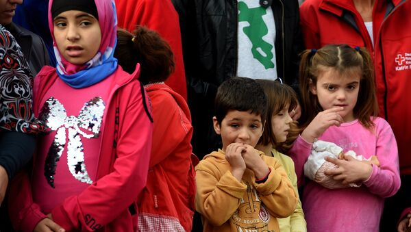 Young migrants wait for the arrival of the German President at an accommodation for refugees in Bergisch Gladbach, western Germany, on November 12, 2015. - Sputnik International
