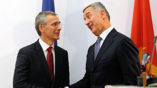 Montenegro's Prime Minister Milo Djukanovic (R) shakes hands with NATO Secretary General Jens Stoltenberg after a joint press conference in Podgorica, October 2015 - Sputnik International