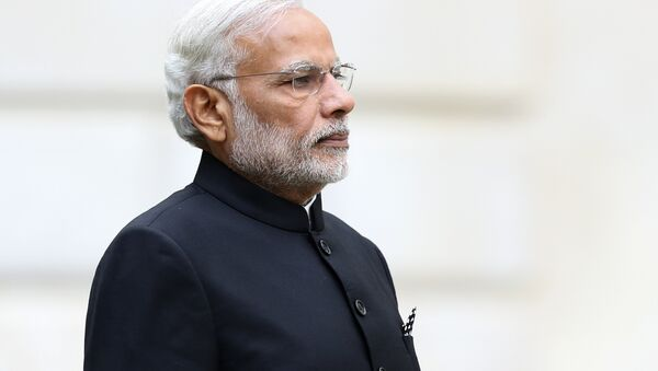 Indian Prime Minister Narendra Modi stands during a welcome ceremony outside the Treasury in London on November 12, 2015 on the first day of a three-day visit to Britain. - Sputnik International