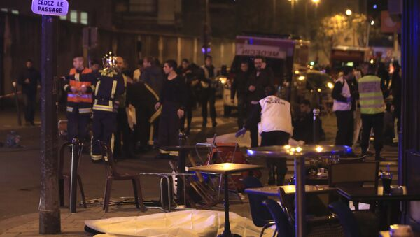Rescue workers and medics work by victims in a Paris restaurant, Friday, Nov. 13, 2015. Police officials in France on Friday reported a shootout in a Paris restaurant and an explosion in a bar near a Paris stadium. - Sputnik International