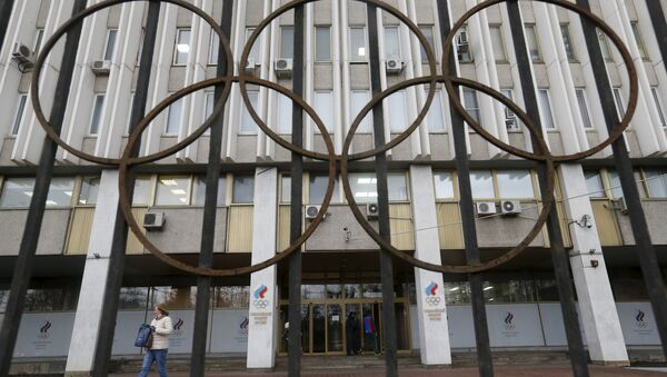 A woman walks out of the Russian Olympic Committee headquarters building, which also houses the management of Russian Athletics Federation in Moscow, Russia, November 13, 2015 - Sputnik International