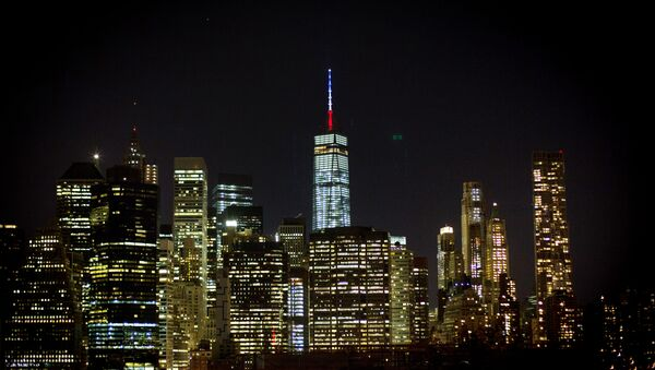 The One World Trade Center spire is lit blue, white and red after New York Gov. Andrew Cuomo announced the lighting in honor of dozens killed in the Paris attacks Friday, Nov. 13, 2015, in New York - Sputnik International
