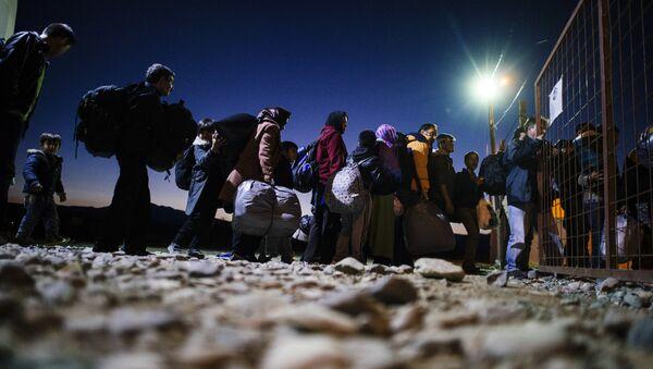 Migrants and refugees enter a registration camp after crossing the Greek-Macedonian border near Gevgelija on November 13, 2015 - Sputnik International