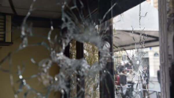 Bullet holes are seen in the window of a Japanese restaurant next to the cafe 'La Belle Equipe' at the Rue de Charonne in Paris on November 14, 2015, following a series of coordinated attacks in and around Paris late Friday - Sputnik International