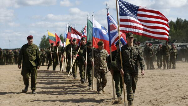 Soldiers from NATO countries attend an opening ceremony of military exercise 'Saber Strike 2015', at the Gaiziunu Training Range in Pabrade some 60km.(38 miles) north of the capital Vilnius, Lithuania, Monday, June 8, 2015 - Sputnik International