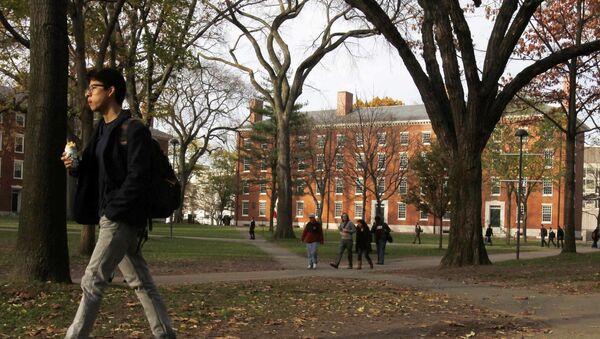 A student walks through Harvard Yard at Harvard University in Cambridge, Massachusetts, in this file photo taken November 16, 2012 - Sputnik International