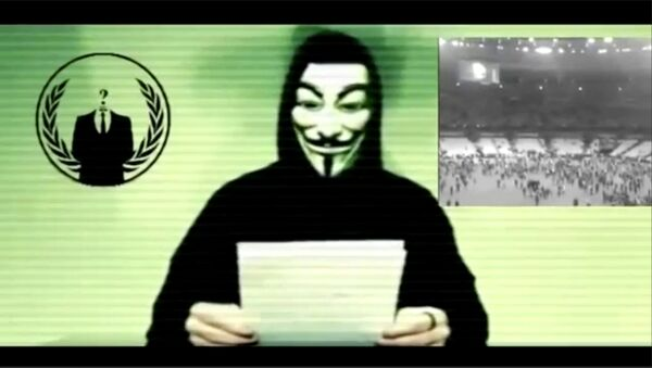 Still image from a video shows a man wearing a mask associated with Anonymous making a statement - Sputnik International