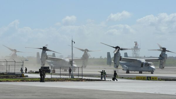 US Marine V-22 Osprey aircraft (R) taxi on the tarmac after the arrival of US President Barack Obama at the international airport in Manila on November 17, 2015, to attend the Asia-Pacific Economic Cooperation (APEC) summit - Sputnik International