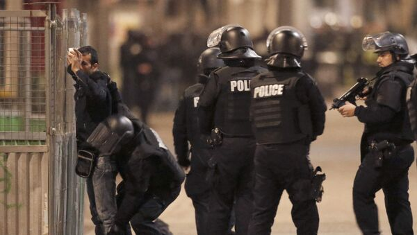 French spolice stop and search a local resident as shots are exchanged in Saint-Denis, France, near Paris, November 18, 2015 during an operation to catch fugitives from Friday night's deadly attacks in the French capital - Sputnik International
