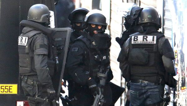 Members of French special police forces of Research and Intervention Brigade arrive during an operation in Saint-Denis, near Paris - Sputnik International