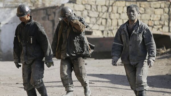 Miners walk at a coal mine from the state-owned Longmay Group on the outskirts of Jixi, in Heilongjiang province, China, October 24, 2015 - Sputnik International