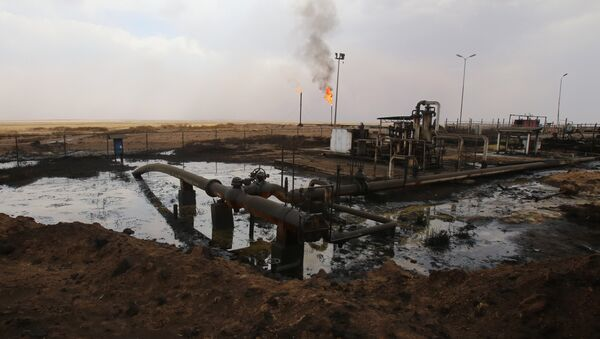 Oil well pumps are seen in the Rmeilane oil field in Syria's northerneastern Hasakeh province on July 15, 2015 - Sputnik International
