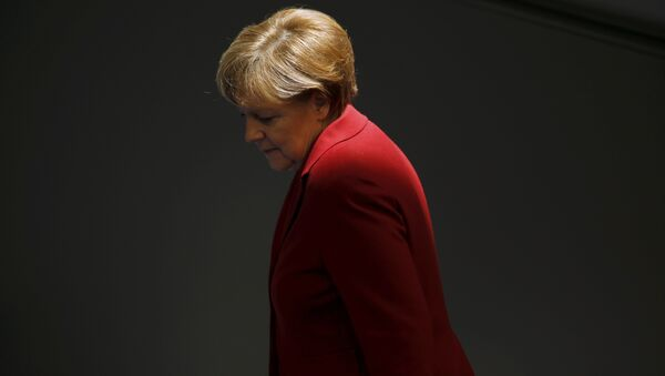 File photo of German Chancellor Angela Merkel attending a debate at the Bundestag, the lower house of parliament, in Berlin March 19, 2015 - Sputnik International