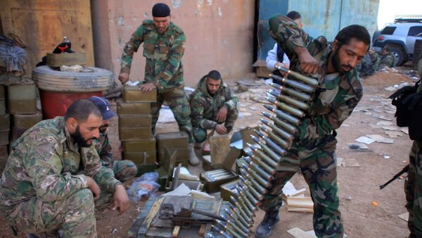 Syrian pro-government forces prepare their weapons at a train station in the area of Arkile near the airport of Kweyris, in the northern Syrian province of Aleppo, on November 20, 2015 - Sputnik International