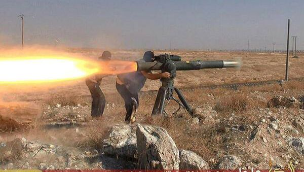 In this picture released on June 26, 2015, by a website of Islamic State militants, Islamic State militants fire an anti-tank missile in Hassakeh, northeast Syria - Sputnik International