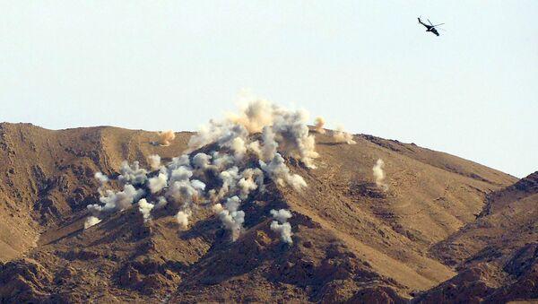Russian helicopters Mi-24p airstrike the terrorists' positions 20 km outside Palmyra - Sputnik International
