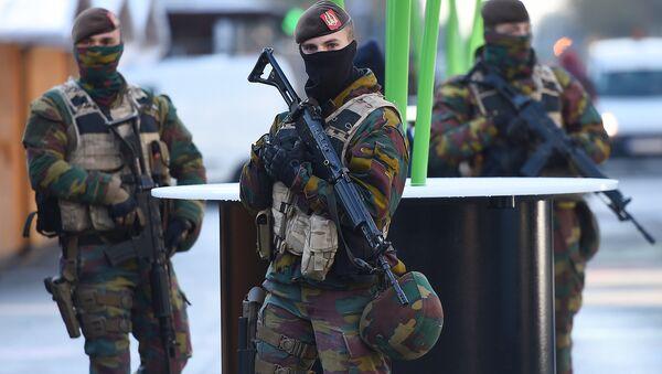 Soldiers patrol as the Belgian capital remains on the highest possible alert level on November 23, 2015 in Brussels - Sputnik International