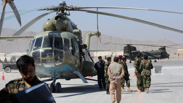 A group of Afghan Nationl Army Air Corps personnel gather beside the Russian Mi-17 transport helicopter in Kandahar air base on October 12, 2009 - Sputnik International