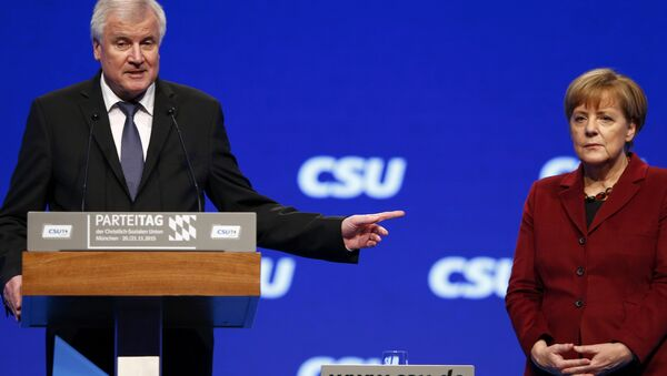 Bavarian Prime Minister and head of the Christian Social Union (CSU) Horst Seehofer welcomes German Chancellor Angela Merkel to the Christian Social Union (CSU) party congress in Munich, Germany in this November 20, 2015 file picture. - Sputnik International