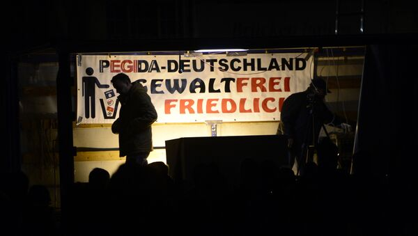 Pegida founder Lutz Bachmann is silhouetted during a demonstration of PEGIDA (Patriotic Europeans against the Islamization of the West) in Dresden, eastern Germany, Monday, Nov. 2, 2015. - Sputnik International
