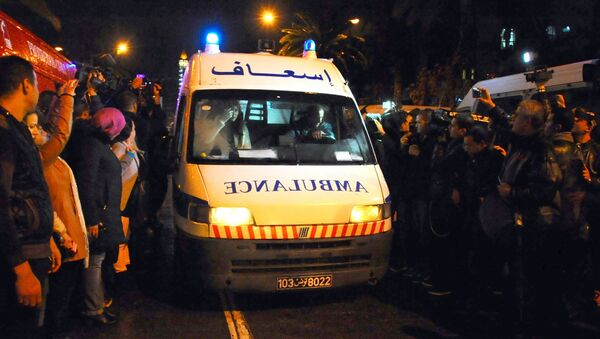 An ambulance rushes to the scene of a bus explosion in the center of the capital, Tunis, Tunisia, Tuesday, Nov. 24, 2015. - Sputnik International