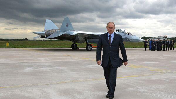 Vladimir Putin at the testing grounds of a Sukhoi T-50 fifth generation fighter. - Sputnik International